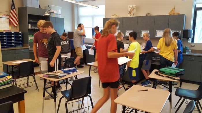 Students are looking for each other's bio-graphs.